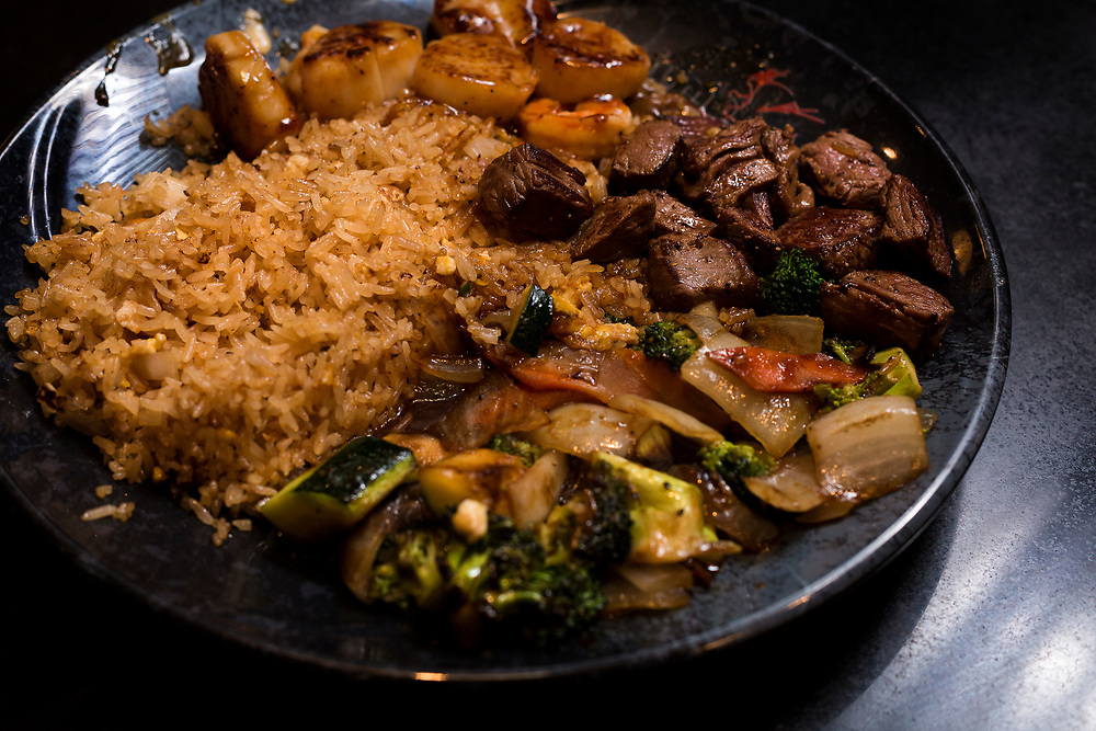 Beef, stir fried vegetables, scallops and fried rice are served at Sumo Japanese Steakhouse & Sushi Bar in Madison, Wisconsin, Wednesday, March 21, 2018.
