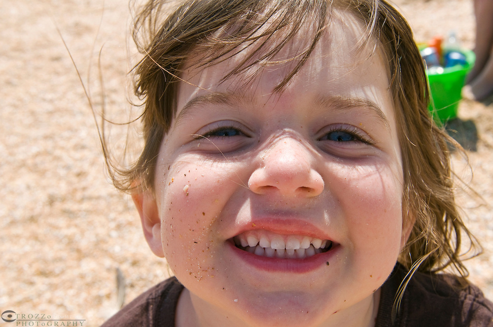 Portrait of a girl, age 4, on the beach.
