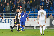 Referee Kevin Friend shows Liam Cooper of Leeds United the red card during the EFL Sky Bet Championship match between Cardiff City and Leeds United at the Cardiff City Stadium, Cardiff, Wales on 26 September 2017. Photo by Andrew Lewis.