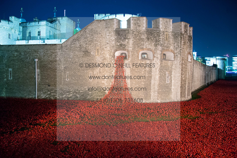 Ceramic artist Paul Cummins installation 'Blood Swept Lands and Seas of Red' featuring 888,246 ceramic poppies in the moat at The Tower of London photographed on 5th November 2014.