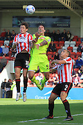James Rowe and Liam Hogan during the Vanarama National League match between Cheltenham Town and Tranmere Rovers at Whaddon Road, Cheltenham, England on 26 September 2015. Photo by Antony Thompson.