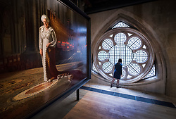 © Licensed to London News Pictures. 29/05/2018. London, UK.  Ralph Heimans' 2012 painting 'The Coronation Theatre: Portrait of Her Majesty Queen Elizabeth II' dominates one of the rooms in the new Queen's Diamond Jubilee Galleries at Westminster Abbey. The recently finished galleries situated in 13th century triforium, 52 feet above the abbey floor, will display treasures not seen by the public before and tell the story of abbey's thousand-year history. Photo credit: Peter Macdiarmid/LNP