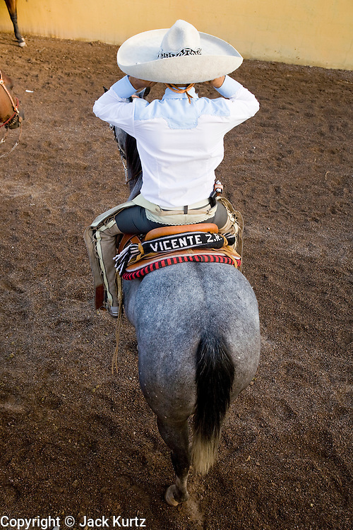 31 AUGUST 2007 -- PHOENIX, AZ: A competitor adjusts his sombrero at the Congreso y Campeonato Nacional Charro in Phoenix, AZ, Friday, August 31. The event is the US championship for the Mexican Federacion Mexicana de Charreria. The winners of the US championship go on to compete in the Mexican Charreada championships in Morelia, Michoacan, Mexico in October. Charreadas are Mexican style rodeos that are popular in Mexican communities throughout the US. As the Mexican immigrant community has expanded throughout the US, the sport has expanded with it. Charreadas are now held as far north as Minnesota and along the US - Mexico border.  Photo by Jack Kurtz