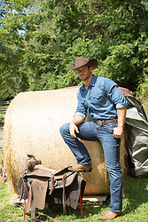 cowboy on a ranch taking a break