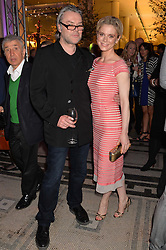 DAVID DOWNTON and EMILIA FOX at a VIP preview of the V&A's new exhibition 'The Glamour of Italian Fashion' - a comprehensive look at Italian Fashion from 1945-2014 held at The Victoria & Albert Museum, London on 2nd April 2014.
