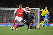 Bayern Munich midfielder Arturo Vidal (23) tackling Arsenal midfielder Alex Oxlade-Chamberlain (15)  during the Champions League round of 16, game 2 match between Arsenal and Bayern Munich at the Emirates Stadium, London, England on 7 March 2017. Photo by Matthew Redman.