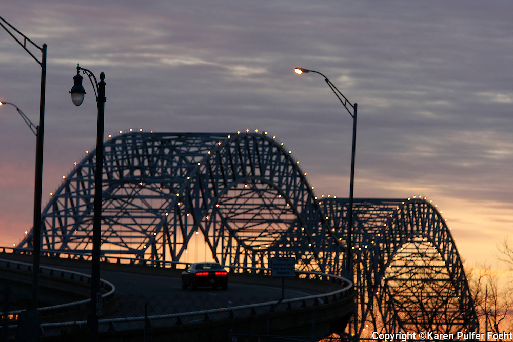 The Memphis bridge is located over the Mississippi River, leading into Arkansas.
