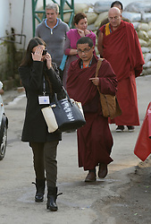 Demi Moore covers her face from being photographed outside the Dalai Lama temple in McLeod Ganj, India, on 29 October 2013. Ms Moore attended the one-week Mind and Life conference on Craving, Desire and Addiction that ended Friday 1st November,  29 October 2013, McLeod Ganj, India. Picture by Lightroom Photos / i-Images