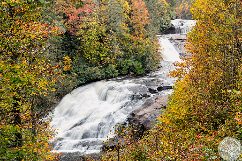The fall colors of DuPont State Forest, near Brevard, NC, frame Triple Falls.