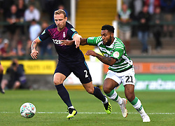 Aston Villa's Axel Tuanzebe and Yeovil Town's Wesley McDonald during the Carabao Cup, First Round match at Huish Park, Yeovil.