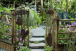 Rustic gate with woven heart shaped panels. The Cumbrian Fellside Garden. Design: Kim Wilde and Richard Lucas - Chelsea 2005