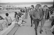 Group of young men walking past swimming pool in Clacton Butlins, Clacton-on-sea, Essex, UK, 1980s