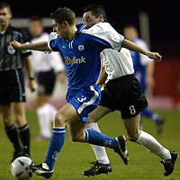 Clyde v St Johnstone..  07.12.02<br />Ross Forsyth fends off a challenge by Andrew Millen<br /><br />Pic by Graeme Hart<br />Copyright Perthshire Picture Agency<br />Tel: 01738 623350 / 07990 594431