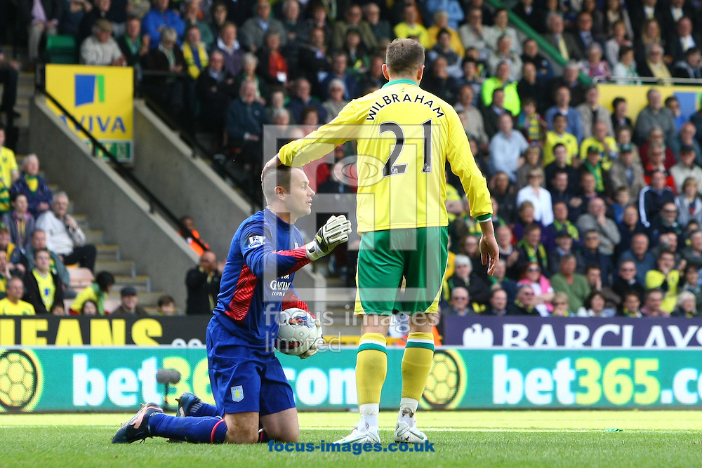 Picture by Paul Chesterton/Focus Images Ltd.  07904 640267.13/05/12.Aaron Wilbraham of Norwich and Shay Given of Aston Villa during the Barclays Premier League match at Carrow Road Stadium, Norwich.