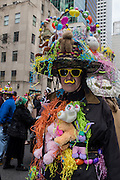New York, NY, USA-27 March 2016. A man wearing an elaborate costume including an Easter basket hat and a multitude of stuffed animals in the annual Easter Bonnet Parade and Festival.