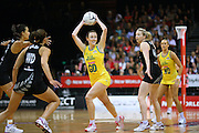 Australia's Rebecca Bulley, centre, looks to pass the ball against New Zealand in the New World Quad series netball match, Claudelands Arena, Hamilton, New Zealand, Thursday, November 01, 2012. Credit:NINZ / Dianne Manson.