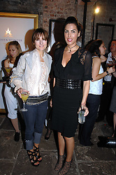 Left to right, DAISY BATES and JESSICA DE ROTHSCHILD at the Stephen Webster launch party of his latest jewellery collection during the London Jewellery Week, at Wilton's Music Hall, Graces Alley, Off Ensign Street, London E1 on 12th June 2008.<br />