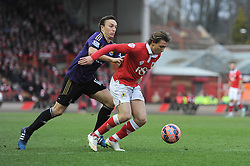 Bristol City's Luke Freeman challenges for the ball with West Ham's Mark Noble - Photo mandatory by-line: Dougie Allward/JMP - Mobile: 07966 386802 - 25/01/2015 - SPORT - Football - Bristol - Ashton Gate - Bristol City v West Ham United - FA Cup Fourth Round