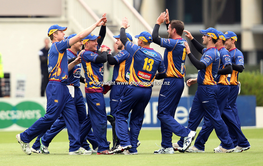 The Otago Volts celebrate taking another wicket.<br /> Twenty20 Cricket - HRV Cup, Otago Volts v Central Stags, 18 December 2011, University Oval, Dunedin, New Zealand.<br /> Photo: Rob Jefferies/PHOTOSPORT