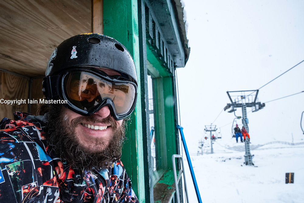 Glenshee, Scotland, United Kingdom. 3 February, 2018. New snow falls at Glenshee Ski Centre in the Cairngorms brought many skiers eager to enjoy the good calm conditions. The weather is expected to be good for the rest of the weekend and large crowds are expected to take advantage of excellent conditions. Pictured David Campbell keeps an eye on chair lift operations,