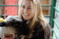 Salinas FFA's Hayden Gray is all smiles with Deacon, a male Hampshire-cross sheep at Salinas' annual Farm Day on Thursday. Thousands of area children spent the morning learning about farming practices, healthy foods, ranch and farm animals, and agricultural technology.