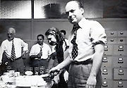 cutting the pre-wedding cake with office worker USA 1940s