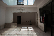 Libia, Tripoli: African migrant prays inside his cell at Abu Salim detention center for illegal migrants. Alessio Romenzi