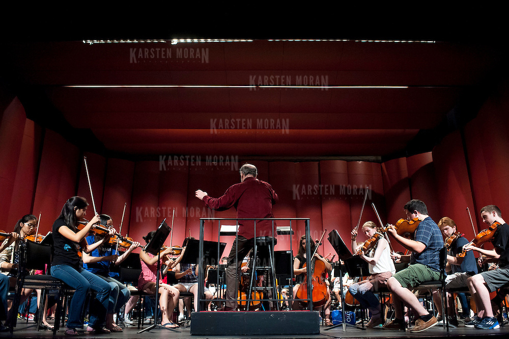July 9, 2013 - Purchase, NY : Russian conductor Valery Gergiev, seated at center, leads the National Youth Orchestra of the United States of America in  rehearsal at SUNY Purchase's Performing Arts Center in Westchester on Tuesday afternoon. The Orchestra, a new project of Carnegie Hall's Weill Music Institute, is comprised of musicians aged 16-19, hand-picked from across the country. The program -- and orchestra -- will kick off its inaugural season with a performance at SUNY Purchase on Thursday evening, and then head off to perform in Washington DC,  Moscow, St. Petersburg, and London. CREDIT: Karsten Moran for The New York Times