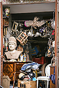 A eclectic assortment of antiques and junk at a stall in the Fiera Antiquaria Napoletana or Naples Antiques Market in Naples, southern Italy.