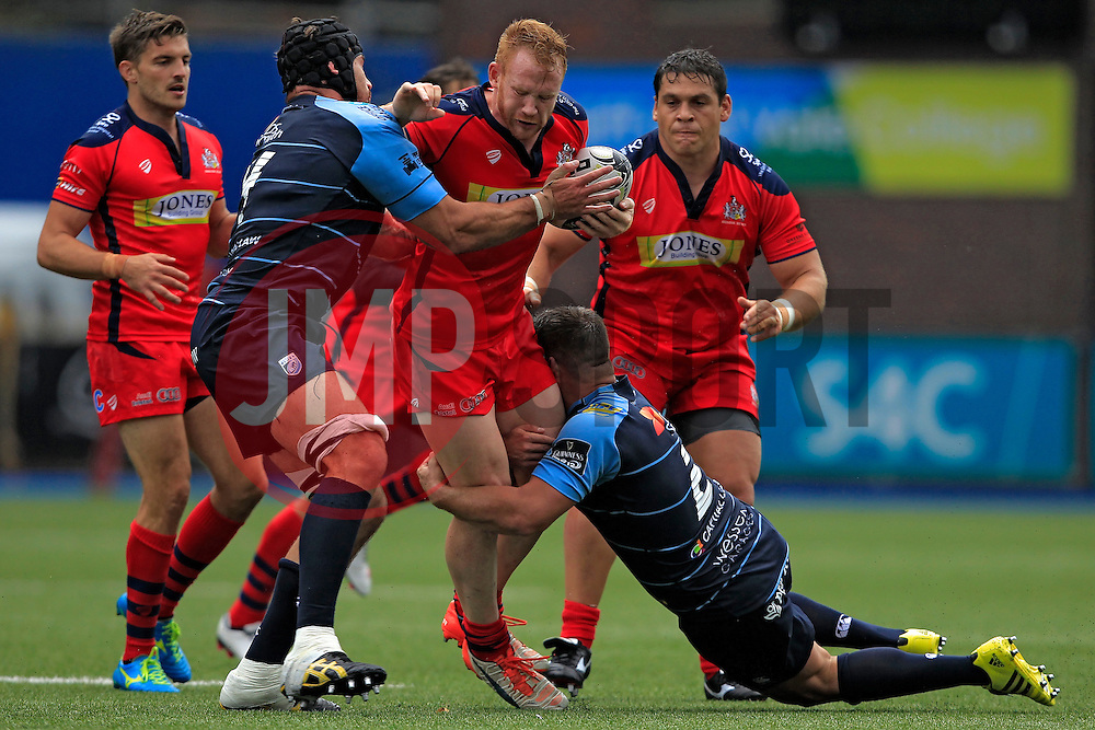 Will Hurrell of Bristol Rugby (C) is tackled by George Earle (L) and Kirby Myhill of Cardiff Blues - Mandatory by-line: Ian Smith/JMP - 20/08/2016 - RUGBY - BT Sport Cardiff Arms Park - Cardiff, Wales - Cardiff Blues v Bristol Rugby - Pre-season friendly