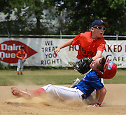 Lane Allen's helmut flies off as he is tagged by 3rd baseman, Brody White of Pappy's. Pappy's beat the Meyers team 11-10 in the farm division quarterfinals at the Shrine Tournament Saturday.