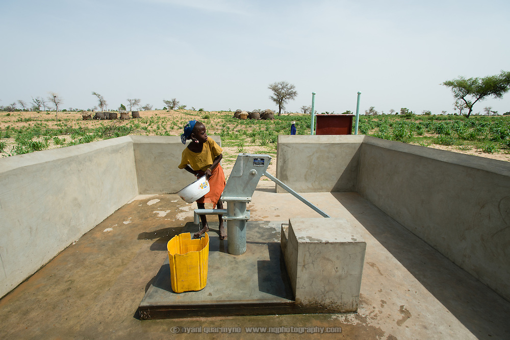A girl at a WaterAid pump in the village of Din-Rimi in the Zinder Region of Niger on 24 July 2013.