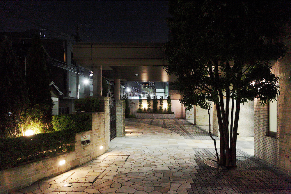 light coming from the entree door of modern residential housing complex