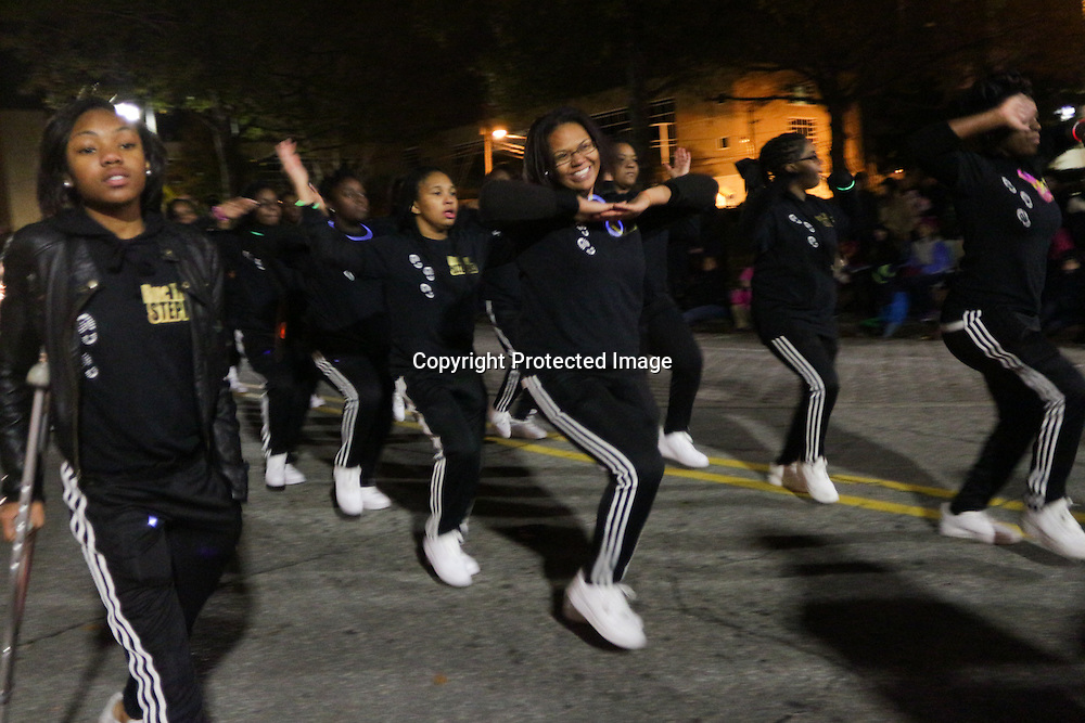 The Buctown Steppers participate in the 12th Annual Wilmington Holiday Parade Sunday December 7, 2014 in Wilmington, N.C. (Jason A. Frizzelle)