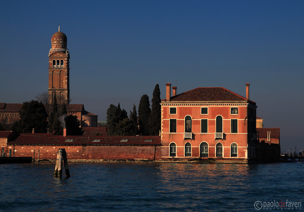 A view from the water bus of the church and bell tower of Madonna dell'Orto. The Madonna dell'Orto is a church in Venice, Italy, in the sestiere of Cannaregio. The church, erected in the second half of the XIV century, is without any doubt one of the finest example of the Venetian gothic architecture.