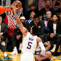 25 December 2017: Los Angeles Lakers guard Josh Hart (5) goes for the dunk past Minnesota Timberwolves center Karl-Anthony Towns (32) during the Minnesota Timberwolves 121-104 victory over the LA Lakers, at the Staples Center, Los Angeles, California, USA.