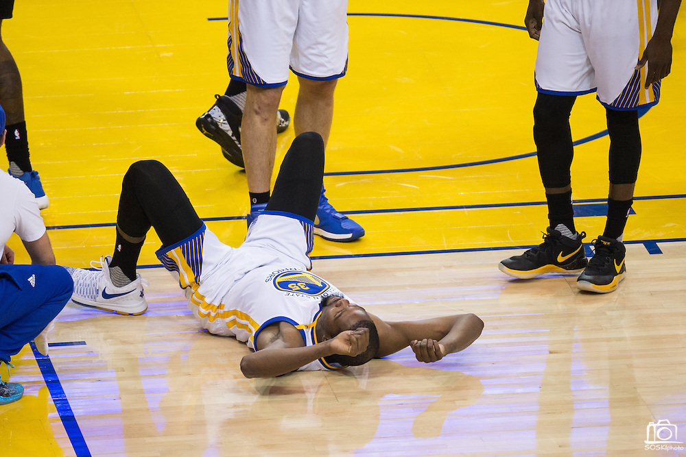 Golden State Warriors forward Kevin Durant (35) lays on the ground after being fouled by the LA Clippers at Oracle Arena in Oakland, Calif., on February 23, 2017. (Stan Olszewski/Special to S.F. Examiner)