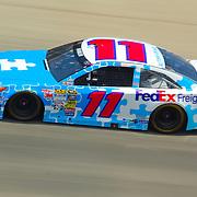 Denny Hamlin (11) of Joe Gibbs Racing speeds down the straight away during the NASCAR SPRINT CUP SERIES FEDEX 400 BENEFITING AUTISM auto race at Dover International Speedway in Dover, DE., Sunday,  June 02, 2013.