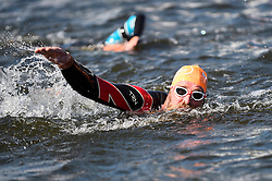 © Licensed to London News Pictures. 21/09/2019. LONDON, UK. One of 6,000 participants finishes the fourth Swim Serpentine, held in the famous lake in Hyde Park.  The event is raising thousands for Children With Cancer Charity UK as swimmers of all abilities navigate the one mile clockwise route around the lake.  Photo credit: Stephen Chung/LNP