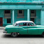Cubans manage their daily life waiting for overcrowded busses, doubling up on old classic cars and motorcycles. Photography by Jose More