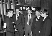 30/03/1963<br /> 03/30/1963<br /> 30 March 1963<br /> Gael - Linn Annual Debating Competition  for Secondary Schools awards presented at the Shelbourne Hotel, Dublin. Ailin Hudson, O'Connell Schools, Dublin (left) showing the Corn Gael-Linn trophy he won for his individual speaking in the National Gael-Linn Annual debating Competition for Secrondary Schools , to members of the Christ the King College, Cork team who competed for Munster. Included are: Sean Mac Carthaigh; Fionnbarra O'hAodha; Padraig O Mathuna and Tomas O Murchu.