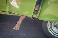 A man's foot sticks out of the door of his Citroen 2CV as he sleeps. He had driven the car to Rio from Argentina and was now living in the car at the site set up for football fans who had nowhere to stay but the tents, campervans, cars and caravans that they had bought with them. The site, at the Terreirao Do Samba, Rio de Janeiro, Brazil, was arranged by the city government once they realised the number of fans in this situation was significant and rather than having them scattered about the sity they offered secure, enclosed accommodation with sanitation and water. The majority of fans at the site were Argentinian but there were also people from Chile, USA, Uruguay and Colombia. <br /> Picture by Andrew Tobin/Focus Images Ltd +44 7710 761829<br /> 06/07/2014