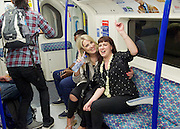 Sadia Khan at London's Night Tube launch at Brixton tube station, London, Great Britain <br /> 19th August 2016 <br /> <br /> Revellers on their way home on the night tube <br /> <br /> Sadia Khan, mayor of London,  launched the first night tube service and travelled on a tube train between Brixton and Walthamstow on the Victoria Line. <br />  <br /> He launched the first 24 hour Friday and Saturday night services on the Central and Victoria lines <br /> <br /> Photograph by Elliott Franks <br /> Image licensed to Elliott Franks Photography Services