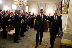 President Barack Obama and Attorney General Eric H. Holder, Jr., depart the State Dining Room of the White House after statements announcing Holder's resignation Sept. 25, 2014. (Official White House Photo by Pete Souza)<br /> <br /> This official White House photograph is being made available only for publication by news organizations and/or for personal use printing by the subject(s) of the photograph. The photograph may not be manipulated in any way and may not be used in commercial or political materials, advertisements, emails, products, promotions that in any way suggests approval or endorsement of the President, the First Family, or the White House.