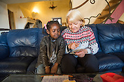 December 6, 2016,  Breil-sur-Roya, French Alpes, France. A refugee child from Sudan plays with the French volunteer Brigitte in the house of Françoise Cotta in the Roya valley they found shelter in. <br /> <br /> 6 décembre 2016, Breil-sur-Roya, Alpes françaises, France. Une enfant réfugiée du Soudan joue avec la volontaire française Brigitte dans la maison de Françoise Cotta dans la vallée de la Roya où ils ont trouvé refuge.