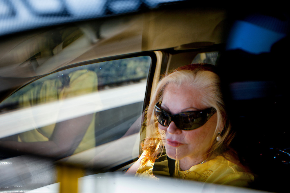 The job is done and Kathie Jo drives the crew home. The mood is light and they discuss the details of the day. Tuesday, March 27, 2012. (photo by Gabriel Romero ©2012)