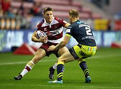 Wigan Warriors' Thomas Davies (left) and Wakefield Trinity's Tom Johnstone during the Betfred Super League Super 8's match at the DW Stadium, Wigan.