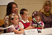 The Nagel triplets, Natalia, Connor and Janessa, sit with their mother, Jodi at the Intermountain Medical Center's 5th anniversary celebration in Murray, Monday, Oct. 29, 2012.