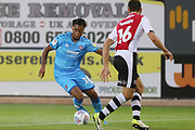 Tahvon Campbell and Gary Warren   during the EFL Trophy match between Exeter City and Cheltenham Town at St James' Park, Exeter, England on 3 September 2019.