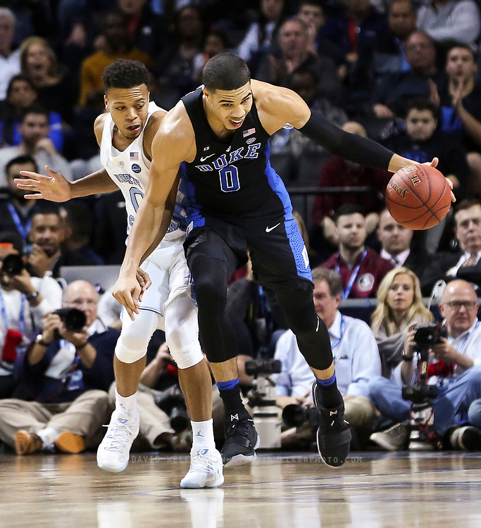 Duke forward Jayson Tatum (0) collides with North Carolina guard Nate Britt (0) while driving up the court during the semifinals of the 2017 New York Life ACC Tournament at the Barclays Center in Brooklyn, N.Y., Friday, March 10, 2017. (Photo by David Welker, theACC.com)